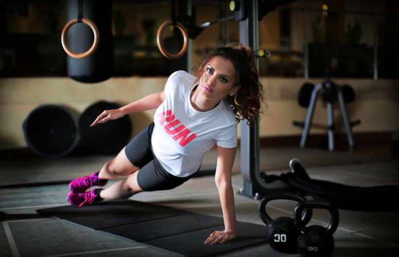 Sports-sensuality-sensual-sexy-woman-girl-body-fitness-workout-dumbbells-model wallpaper