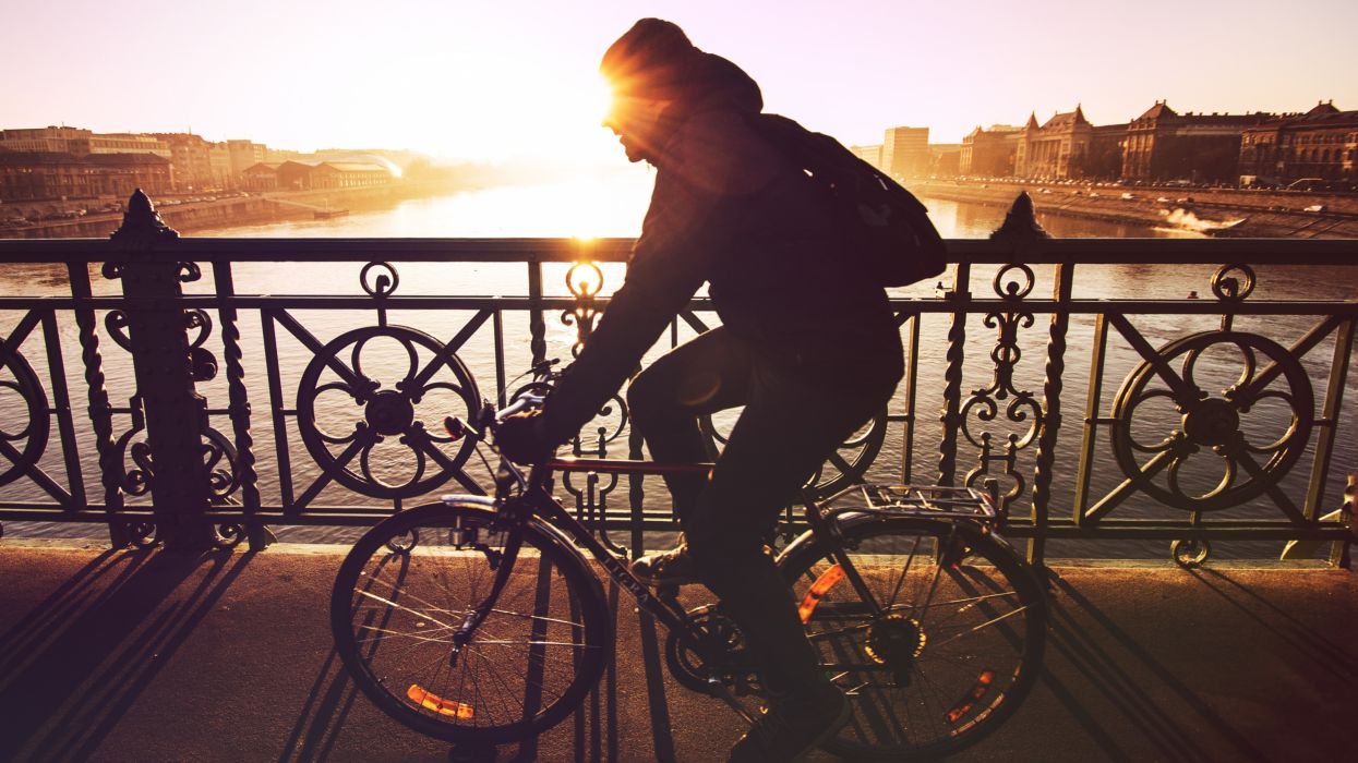 bicycle bridge cold commuting cycling cyclist exercise healthy man railings sun sunglare sunrise sunset winter wallpaper