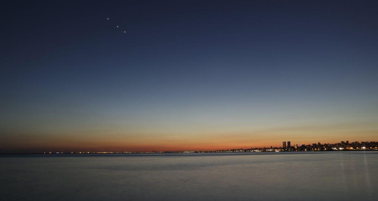 city cityscape dusk evening sea seaside sky stars water BurakKebapci wallpaper