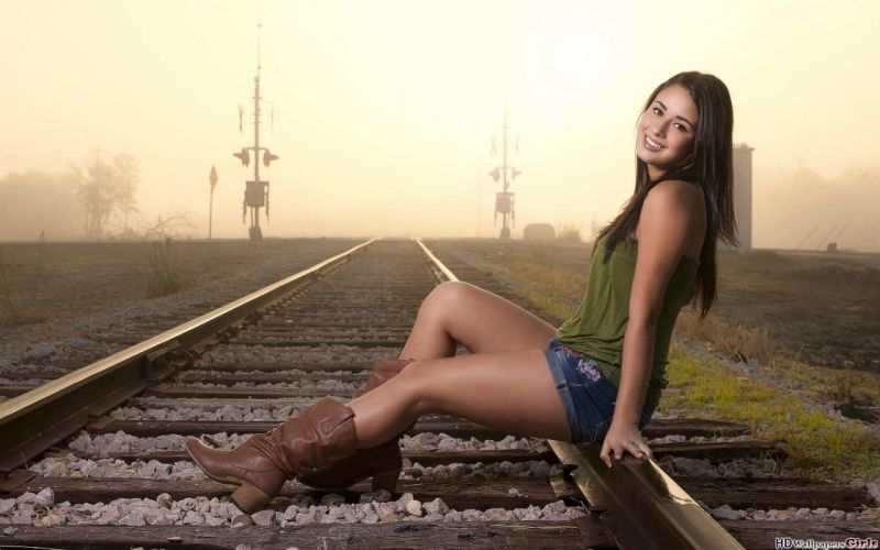Sensuality-sensual-sexy-woman-girl-shorts-jeans-denim-model-sitting-boots-smiling-railway wallpaper