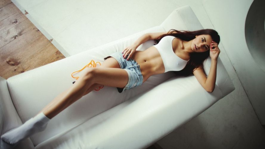 Sensuality-sensual-sexy-woman-girl-shorts-jeans-denim-torn-model-Helga Lovekate-lying-couch-legs wallpaper