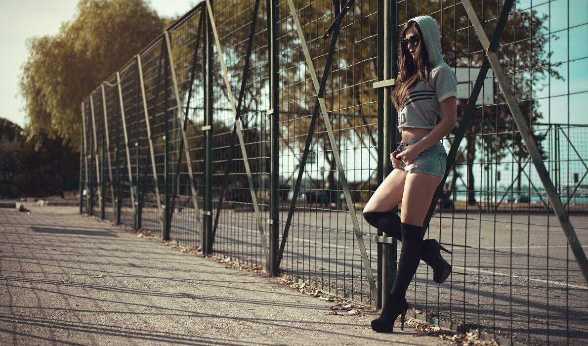 Sensuality-sensual-sexy-woman-girl-shorts-jeans-denim-torn-model-fence-sunglasses-legs-boots-hoods wallpaper