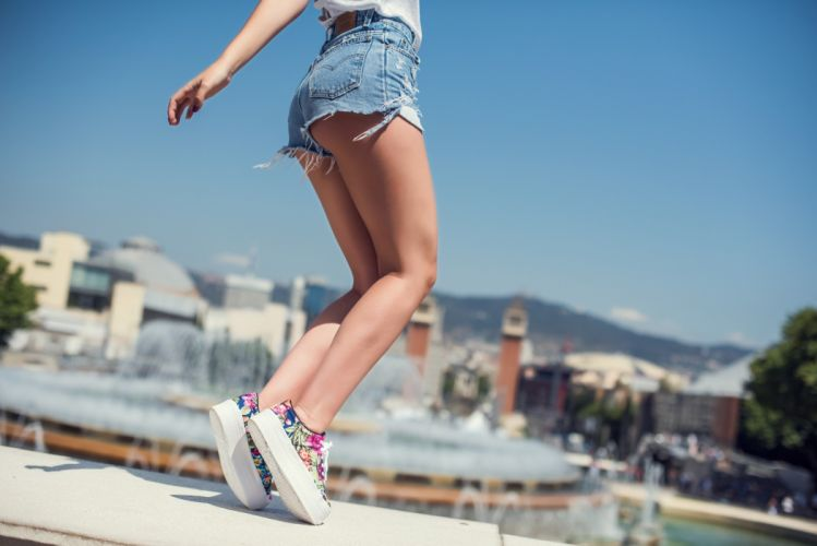 Sensuality-sensual-sexy-woman-girl-shorts-jeans-denim-torn-sneakers-thighs-legs-jump wallpaper