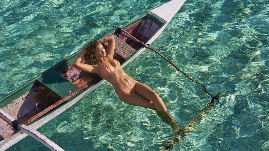Photography-sensuality-sensual-sexy-woman-girl-Gigi Hadid-sunbathing-model-sea-water-boat wallpaper