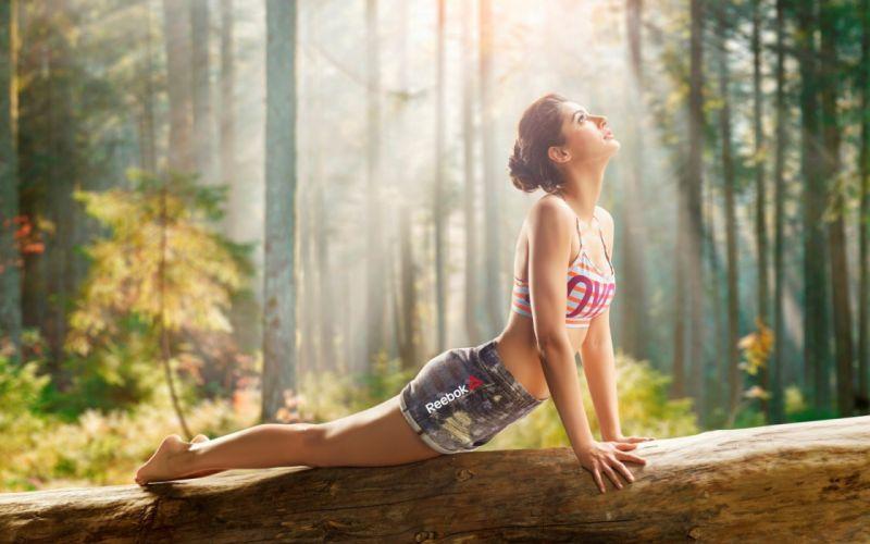 Photography-sensuality-sensual-sexy-woman-girl-modelo-Nargis Fakhri-short-jeans-denim-stretching-trunk wallpaper