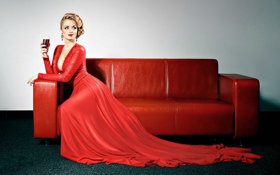 Photography-sensuality-sensual-sexy-woman-girl-red dress-cleavage-sitting-sofa wallpaper