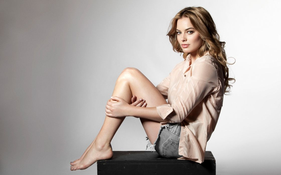 Sensuality-sensual-sexy-woman-girl-short-jeans-denim-shirt-legs-sitting-barefoot wallpaper