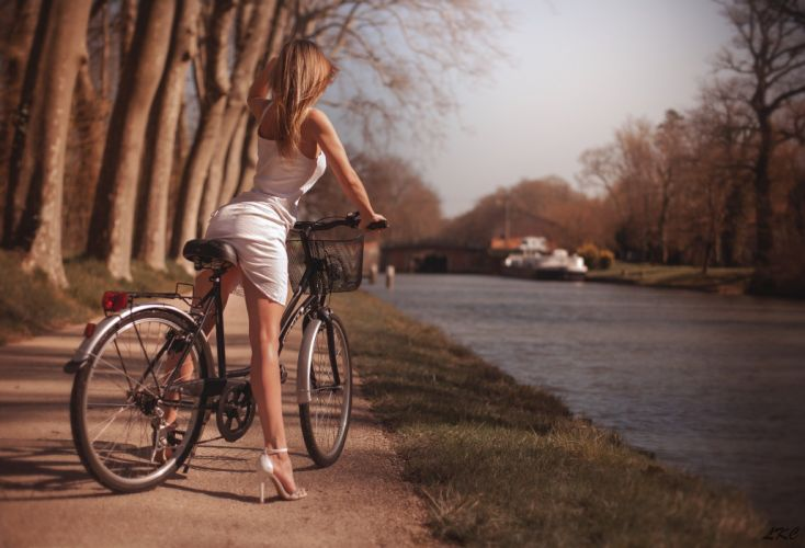 Photography-bicycle-sensuality-sensual-sexy-woman-girl-legs-dress-high heels-trees-river wallpaper