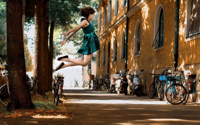Photography-bicycle-sensuality-sensual-sexy-woman-girl-jumping-street-lights-trees-mood wallpaper