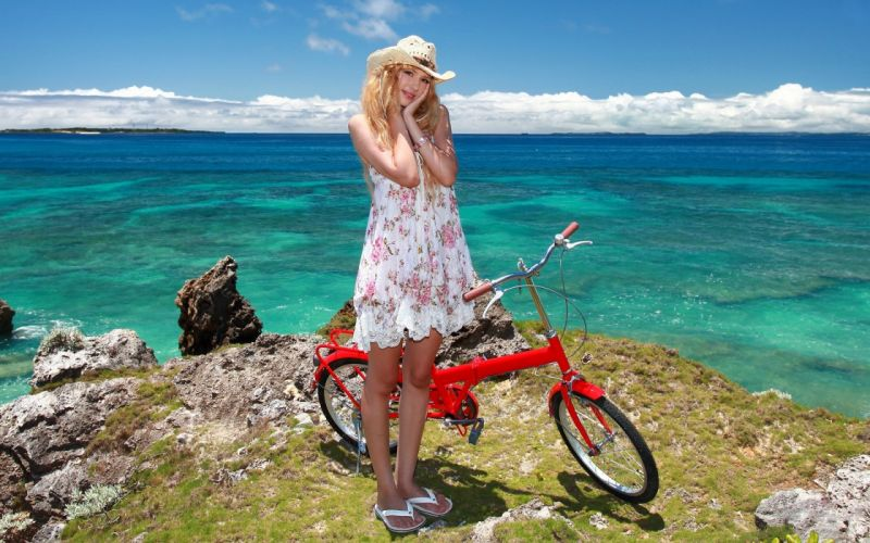 Photography-bicycle-sensuality-sensual-sexy-woman-girl-legs-hat-sea-sky-rock-nature wallpaper