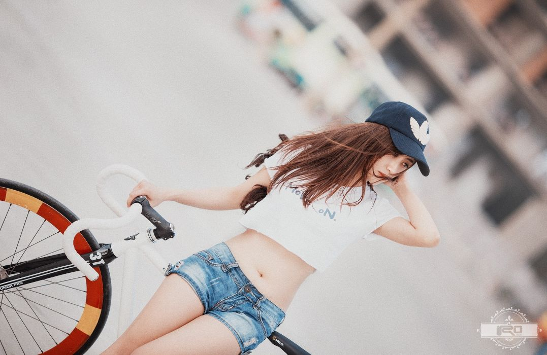 Photography-bicycle-sensuality-sensual-sexy-woman-girl-shorts-jeans-denim-asian-belly-tummy-navel wallpaper
