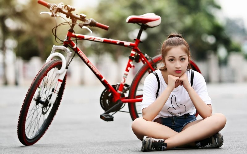 Photography-bicycle-sensuality-sensual-sexy-woman-girl-shorts-jeans-denim-model-asian-sitting wallpaper