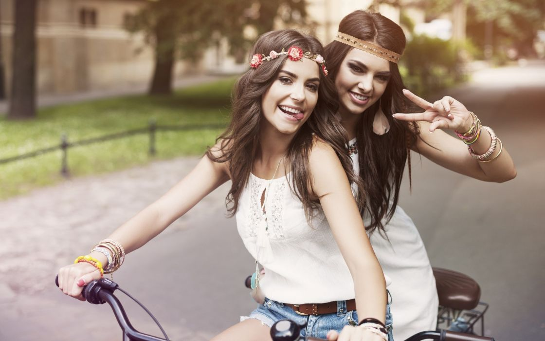 Photography-bicycle-sensuality-sensual-sexy-woman-girl-shorts-jeans-denim-torn-couple-smiling-tongue-wreaths-urban-street wallpaper