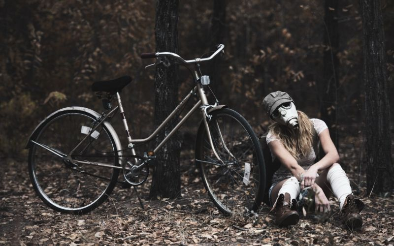 Photography-bicycle-sensuality-sensual-sexy-woman-girl-shorts-jeans-denim-torn-gas mask-boots-sitting wallpaper