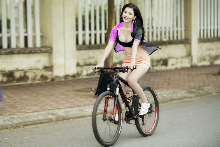Photography-bicycle-sensuality-sensual-sexy-woman-girl-skirt-jeans-denim-asian-road-cleavage wallpaper