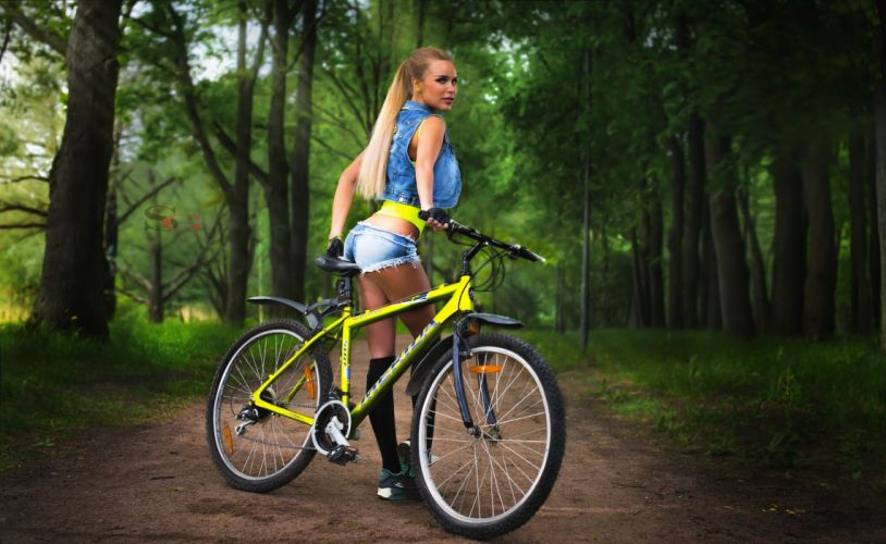 Photography-bicycle-sensuality-sensual-sexy-woman-girl-shorts-jeans-denim-torn-stockings-sneakers-trees wallpaper