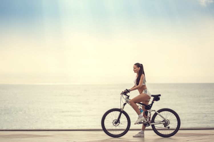 Photography-bicycle-sensuality-sensual-sexy-woman-girl-shorts-model-sea wallpaper