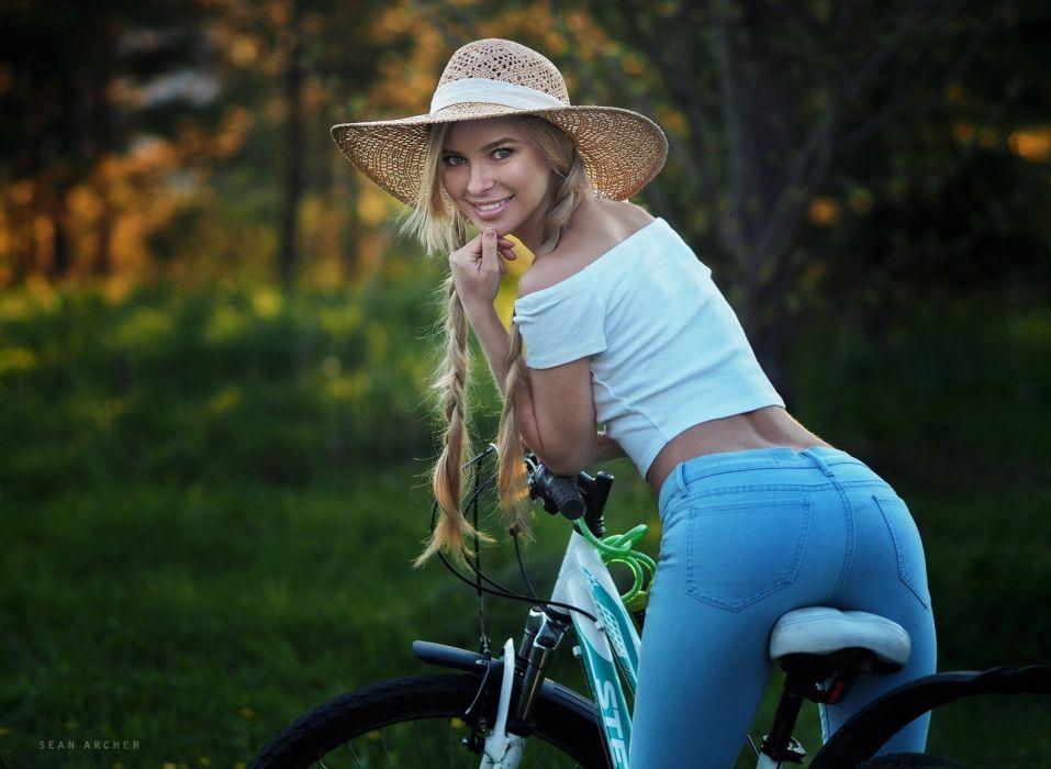 Photography-bicycle-sensuality-sensual-sexy-woman-girl-Victoria Pichkurova-model-braids-jeans-hat-smiling-Sean Archer wallpaper