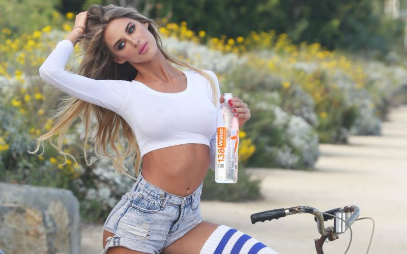 Sensuality-bicycle-sensual-sexy-woman-girl-shorts-jeans-denim-torn-Brittany Cole-belly-tummy-navel wallpaper