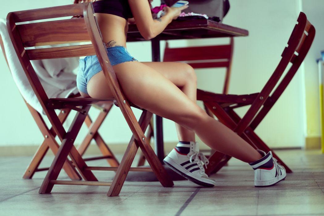 Sensuality-sensual-sexy-woman-girl-shorts-jeans-denim-torn-model-legs-sneakers-sitting-tattoo-Esteban Montoya wallpaper