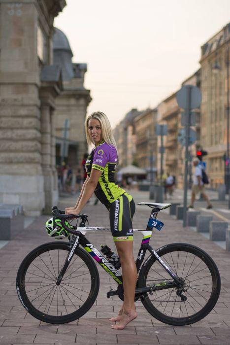 Sports-bicycle-sensuality-sensual-sexy-woman-girl-shorts-street-barefoot-triathlon-tight wallpaper