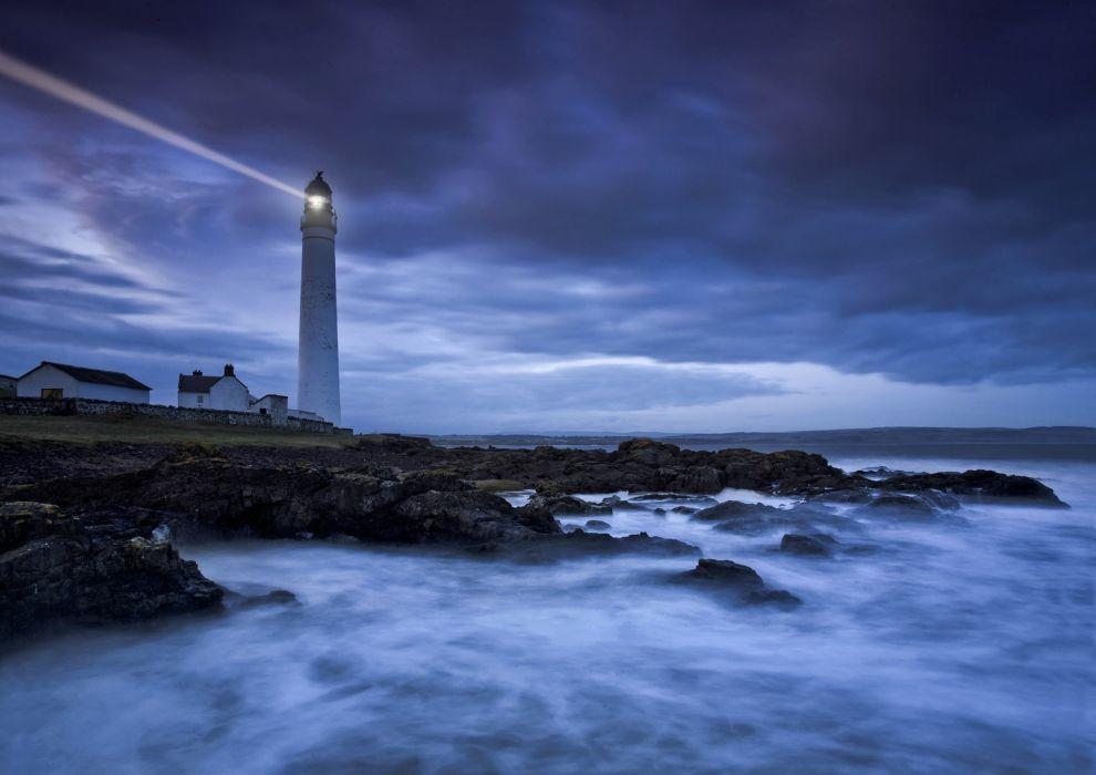 lighthouse sea coast clouds dark rocks wallpaper