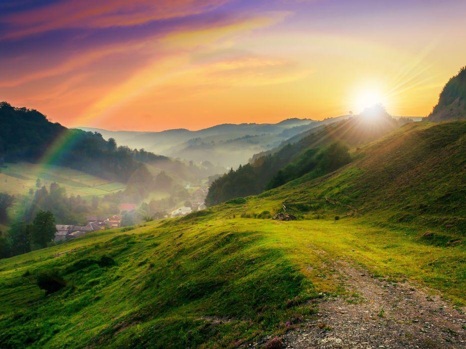 Rainbow over the green hills sunset tree sun grass evening clouds summe rrainbow road hill sky wallpaper