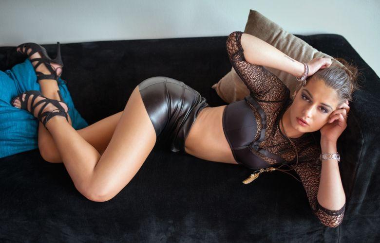 Sensuality sensual sexy woman girl short skirt model high heels couch legs bra belly tummy wallpaper