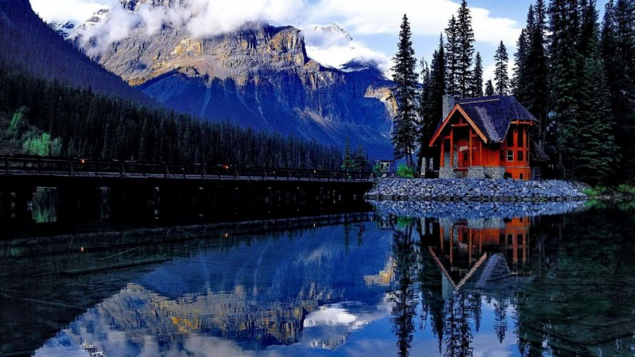house-on-the-shore-of-the-mirrored-lake Lake Calm Snowy Shore Beautiful Water Trees Riverbank House Mirrored Peaceful River Clou wallpaper