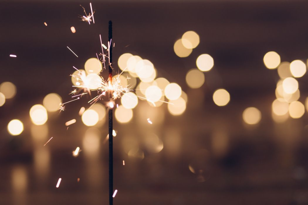 abstract art blur bokeh bright celebration close-up color dark evening fireworks focus glisten gold light lights luminescence new year night season shining wallpaper