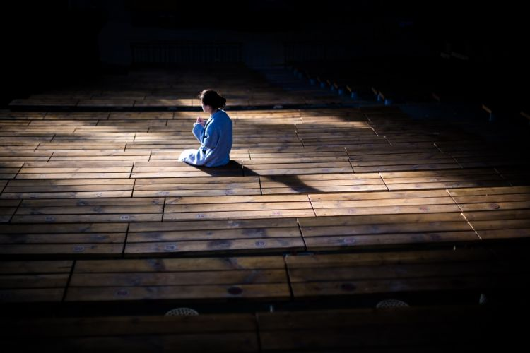 adult alone dark girl light lonely peaceful person shadow waiting woman wood wooden flooring wallpaper