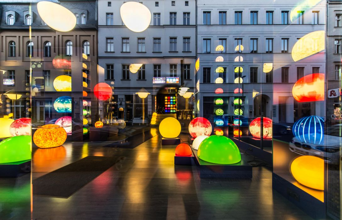 architecture building business colorful colourful downtown evening hallway illuminated lights mirroring modern outdoors road street town traffic urban wallpaper