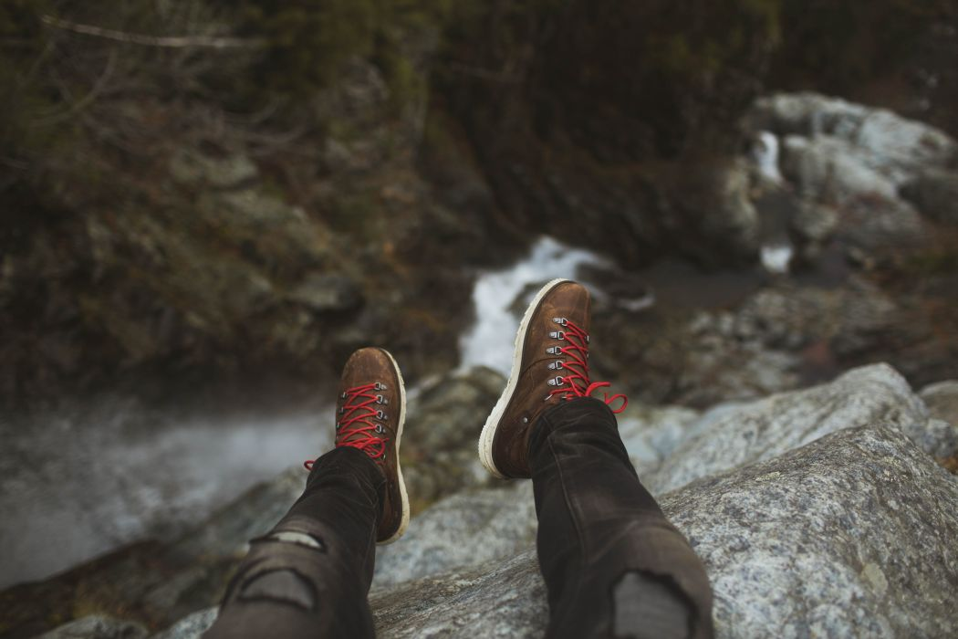 cliff feet man mountain outdoors perspective river rocks shoes water wallpaper