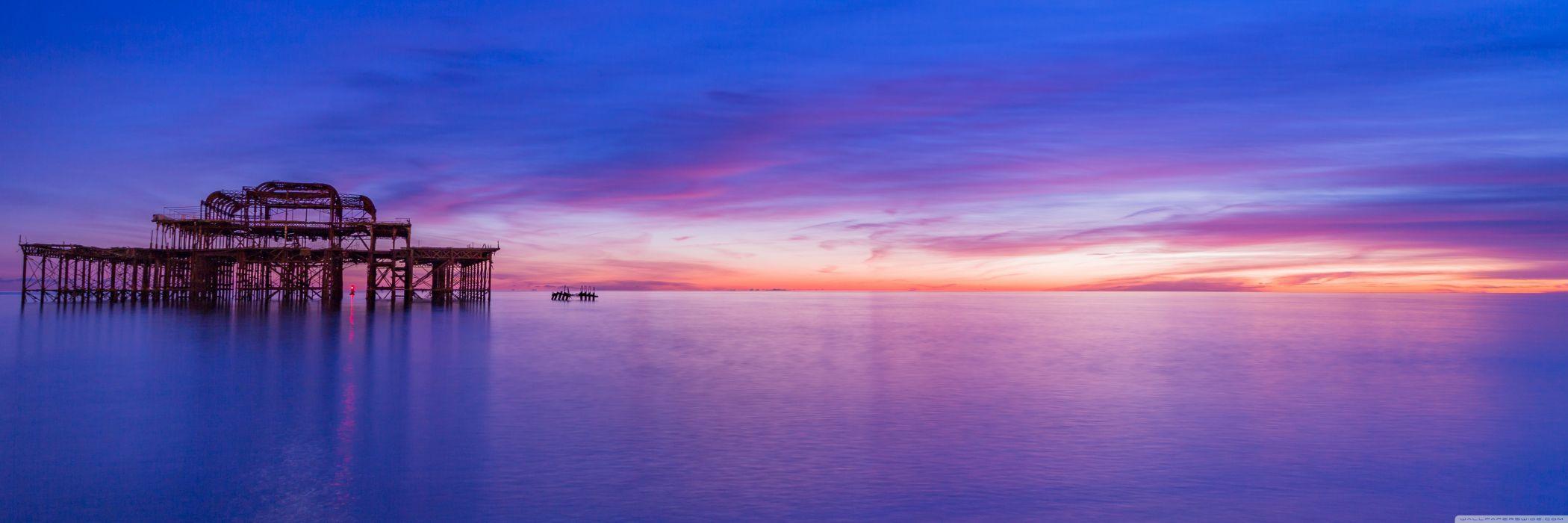brighton pier sunset- unitedkingdom brighton landscape water sunset ocean sky clouds beach nature city night wallpaper