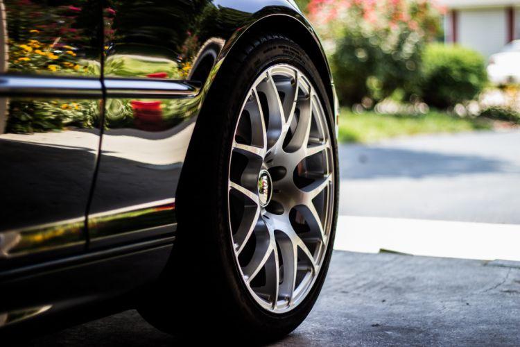 asphalt auto automobile automotive blur car close-up reflection rim road tarmac tire tyre vehicle wheel wallpaper