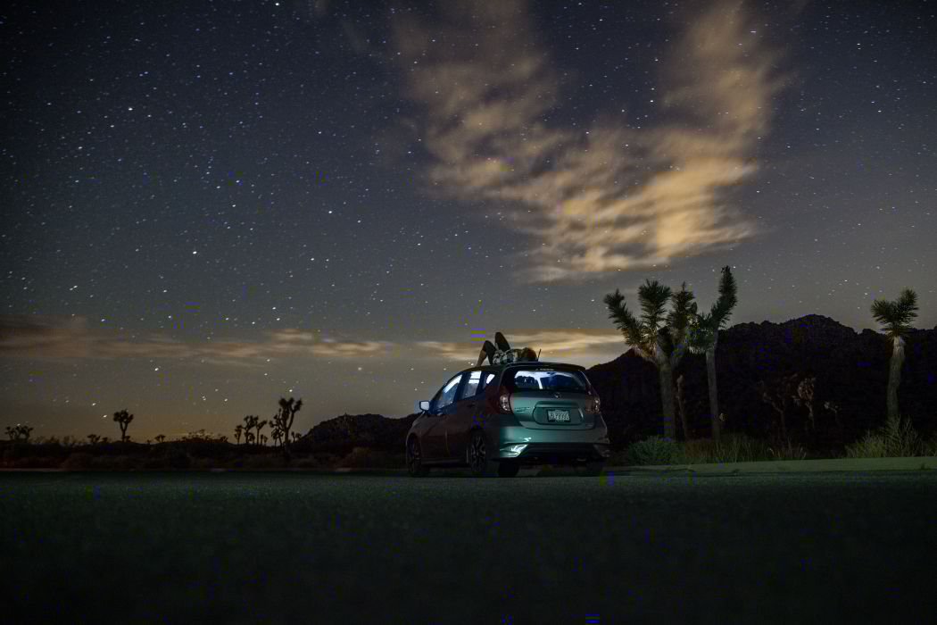 Gray Suv Under Blue Starry Sky during Nighttime wallpaper
