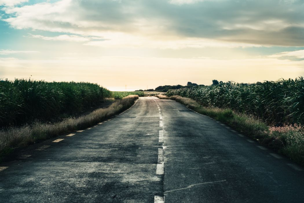 asphalt countryside dawn dusk grass outdoors perspective road sky travel wallpaper