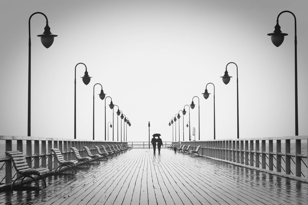 affection benches black and-white boardwalk bridge couple dating engagement feelings fence holding hands lamp posts leisure lifestyle light love man ocean outdoors partner peace people wallpaper