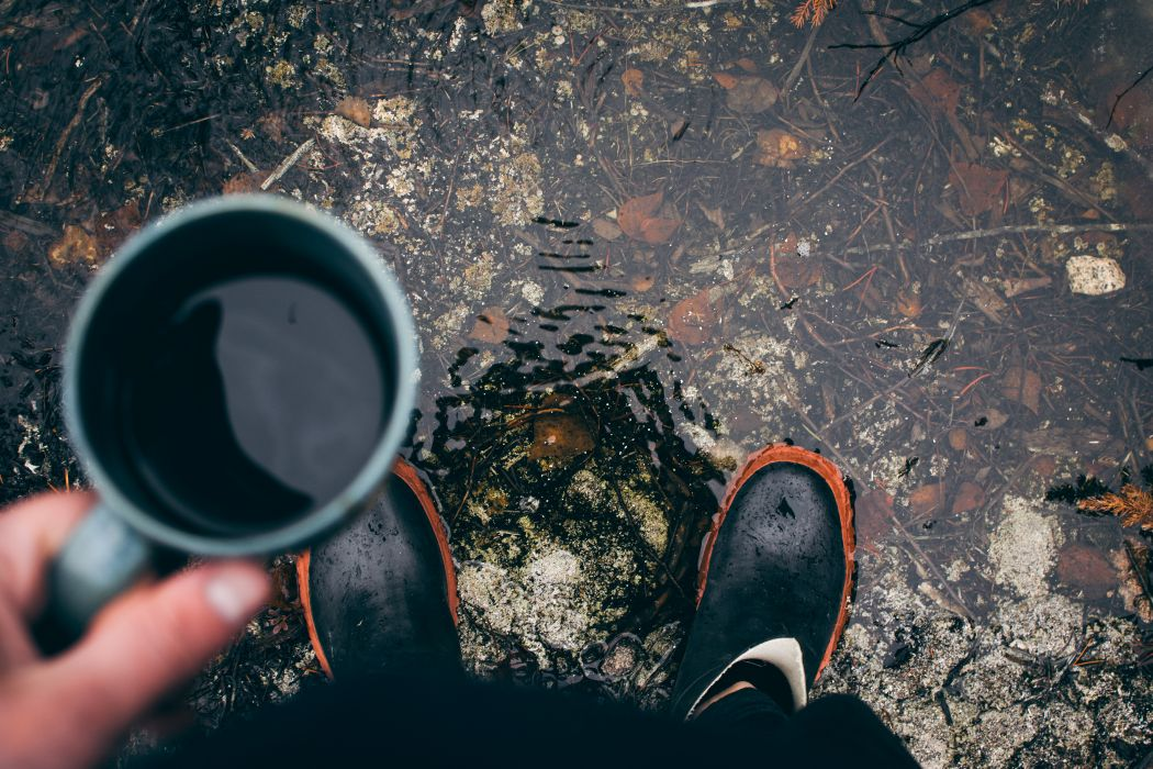 adult black coffee boots calamity cup dark dirty drink high angle shot leaves light man outdoors people person portrait relaxation standing travel underwater water wet wallpaper