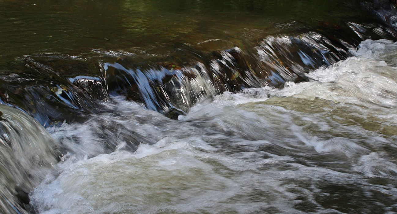 cascade flow flowing motion nature rapids river splash stream water water flow wallpaper