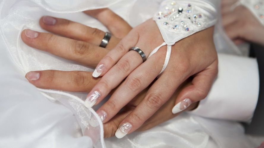 Hands-nails-fingers-couple-wedding-marriage-rings-groom-bride-decoration wallpaper