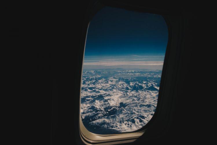 airplane bright clouds dark landscape sky snow travel view window wallpaper