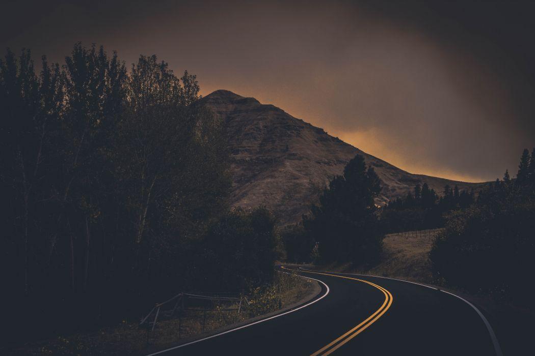 backlit dark dark clouds dawn dusk evening fog grass highway landscape light mountain nature outdoors road scenic sky sunrise sunset travel trees woods wallpaper