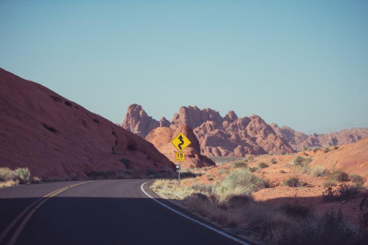 australia curve desert dry red road rocks sign street wallpaper