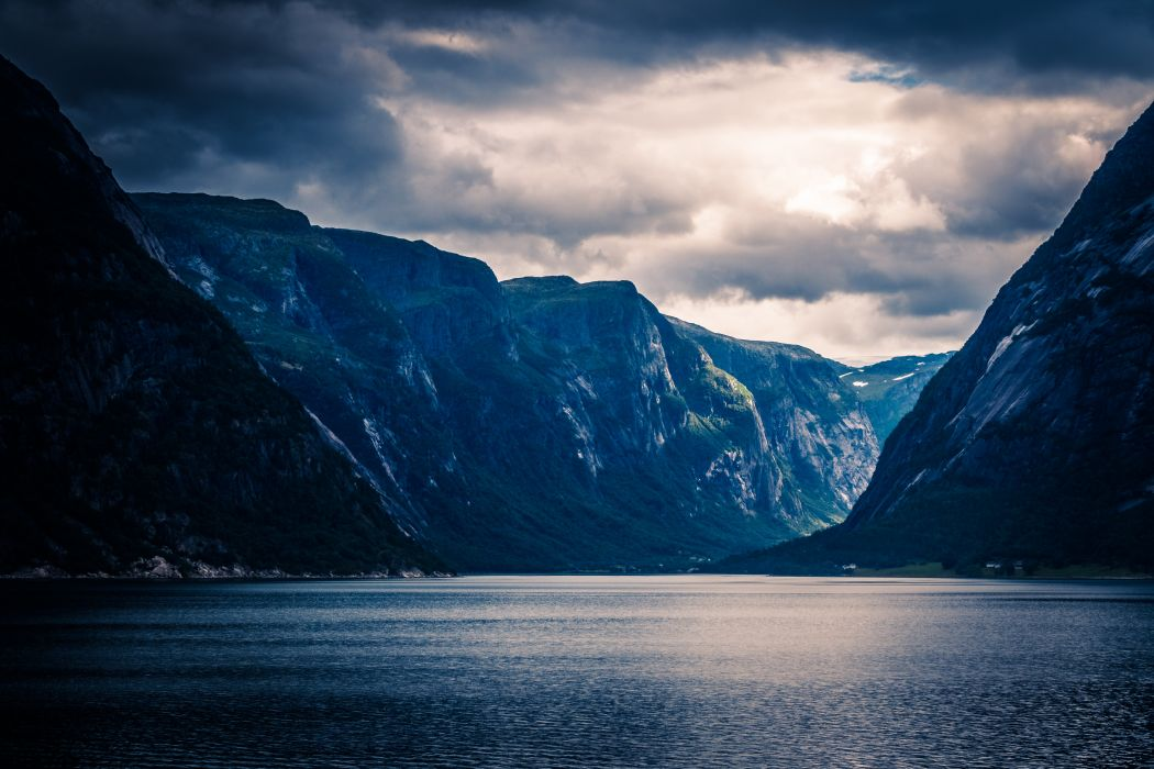 calm waters cliffs clouds daylight fjord frosty hike lake landscape mountain range mountains nature norway outdoors peaks scenic water wallpaper