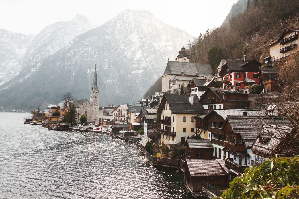 architecture austria building church daylight fjord Hallstatt hill houses island lake landscape mountain outdoors scenic seashore sight tourism town trees village water waterfront winter royalty free images wallpaper