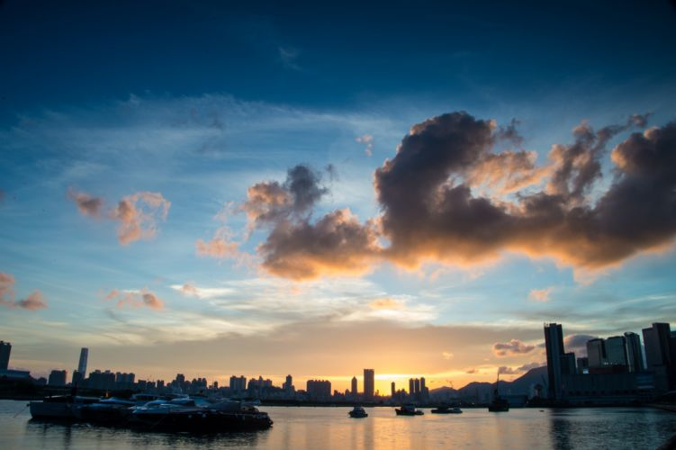 architecture boats buildings calm waters city cityscape clouds dark dawn downtown dusk evening harbor hongkong landscape light ocean outdoors panoramic wallpaper