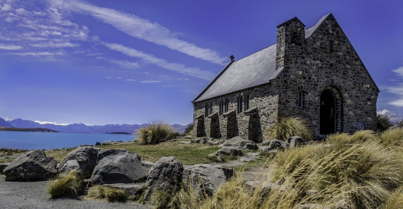 ancient architecture building church clouds daylight facade grass historic landscape outdoors rocks roof scenic sky stone stone wall tourism travel wallpaper