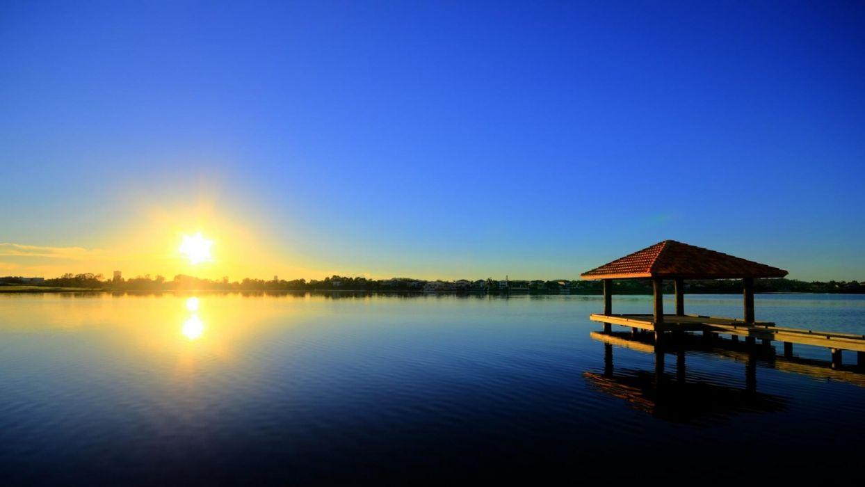 beautiful-sunrise-on-a-peaceful-lake wallpaper