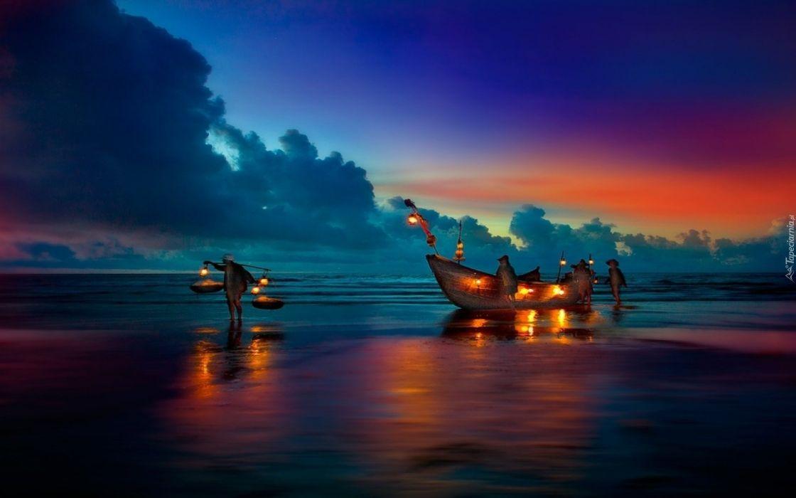 puesta sol mar playa barco pescadores wallpaper